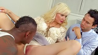 Big boobed blonde Margo Russo opens her legs and offers her wet pink pussy to black guy in her husbands office. Black guy with tattoos and piercing cant wait to stick his big dick in her vagina